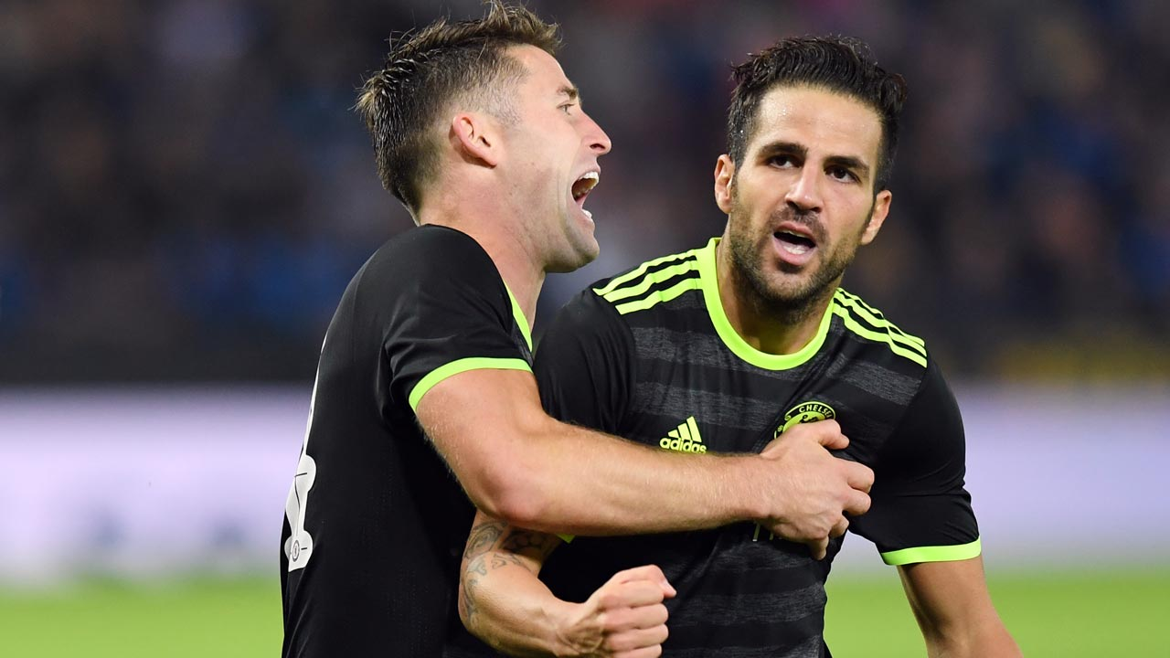 Chelsea's Spanish midfielder Cesc Fabregas (R) celebrates after scoring their fourth goal with teammate Chelsea's English defender Gary Cahill (L) during the English League Cup third round football match between Leicester City and Chelsea at King Power Stadium in Leicester, central England on September 20, 2016. Chelsea won the game 4-2 after extra time. ANTHONY DEVLIN / AFP