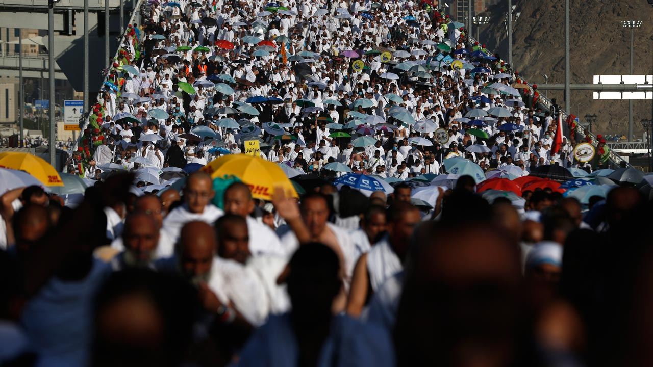 "Muslim pilgrims arrive to throw pebbles at pillars during the ""Jamarat"" ritual, the stoning of Satan, in Mina near the holy city of Mecca, on September 12, 2016. Pilgrims pelt pillars symbolizing the devil with pebbles to show their defiance on the third day of the hajj as Muslims worldwide mark the Eid al-Adha or the Feast of the Sacrifice, marking the end of the hajj pilgrimage to Mecca and commemorating Abraham's willingness to sacrifice his son Ismail on God's command in the holy city of Mecca. PHOTO: AHMAD GHARABLI / AFP"