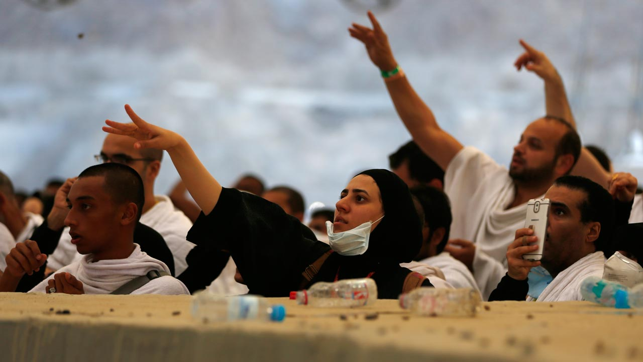 "Muslim pilgrims throw pebbles at pillars during the ""Jamarat"" ritual, the stoning of Satan, in Mina near the holy city of Mecca, on September 12, 2016. Pilgrims pelt pillars symbolizing the devil with pebbles to show their defiance on the third day of the hajj as Muslims worldwide mark the Eid al-Adha or the Feast of the Sacrifice, marking the end of the hajj pilgrimage to Mecca and commemorating Abraham's willingness to sacrifice his son Ismail on God's command in the holy city of Mecca. PHOTO: AHMAD GHARABLI / AFP"