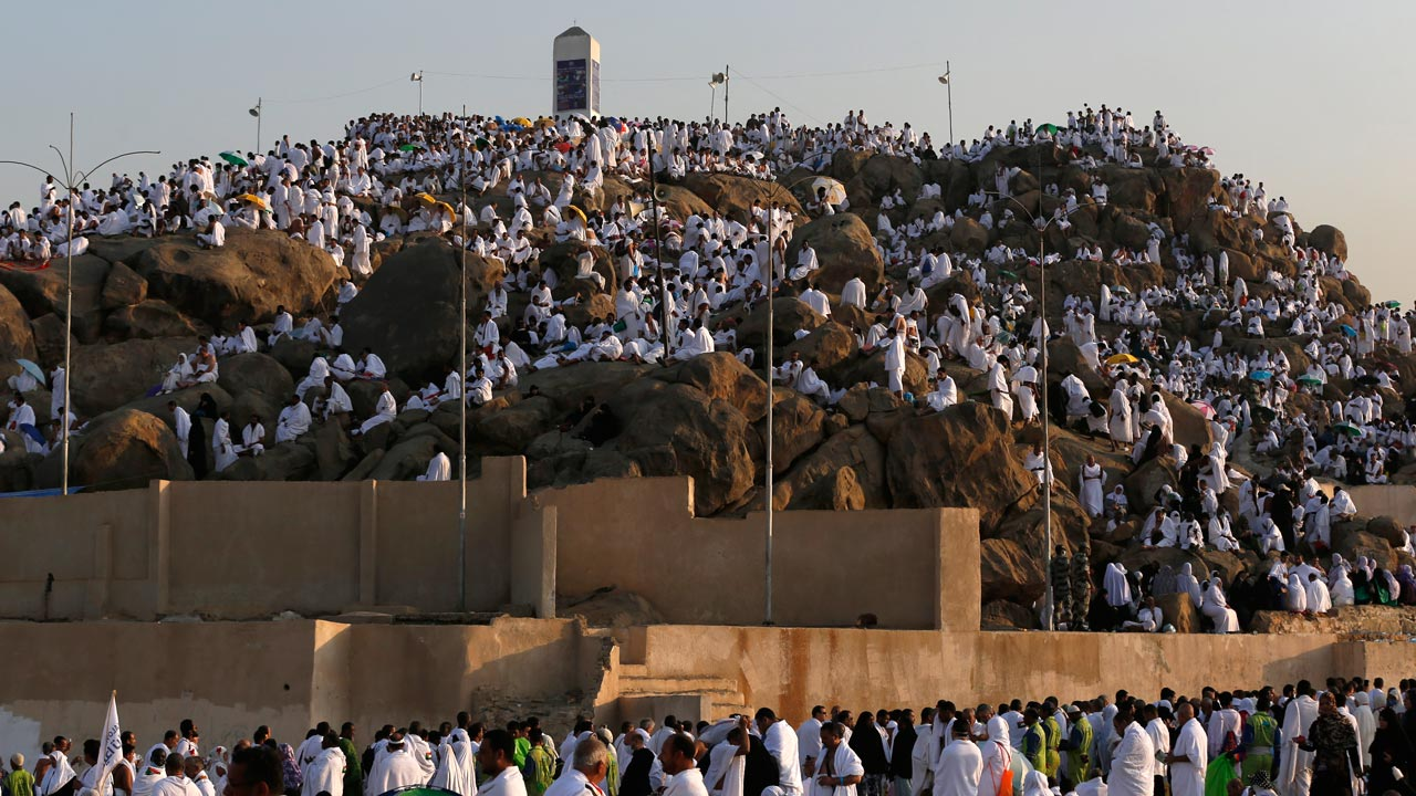 Muslim pilgrim join one of the Hajj rituals on Mount Arafat near Mecca early on September 11, 2016. Close to 1.5 million Muslims from around the world prepared on September 10 night for the climax of the annual hajj pilgrimage at a rocky hill known as Mount Arafat. The pilgrims will mark September 11 with day-long prayers and recitals of the Koran holy book at the spot in western Saudi Arabia where they believe their Prophet Mohammed gave his last hajj sermon. PHOTO: AHMAD GHARABLI / AFP
