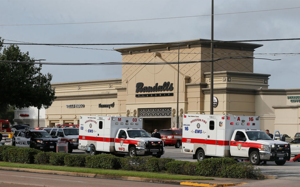 HOUSTON, TX - SEPTEMBER 26: Ambulance crews on standby after a gunman went on a shooting rampage wounding nine before he was shot and killed by police on September 26, 2016 in Houston, Texas. Three victims have been transported to Southwest Memorial Hospital, one has been taken to Ben Taub General Hospital and two have been transported to Memorial Hermann - Texas Medical Center.   Bob Levey/Getty Images/AFP