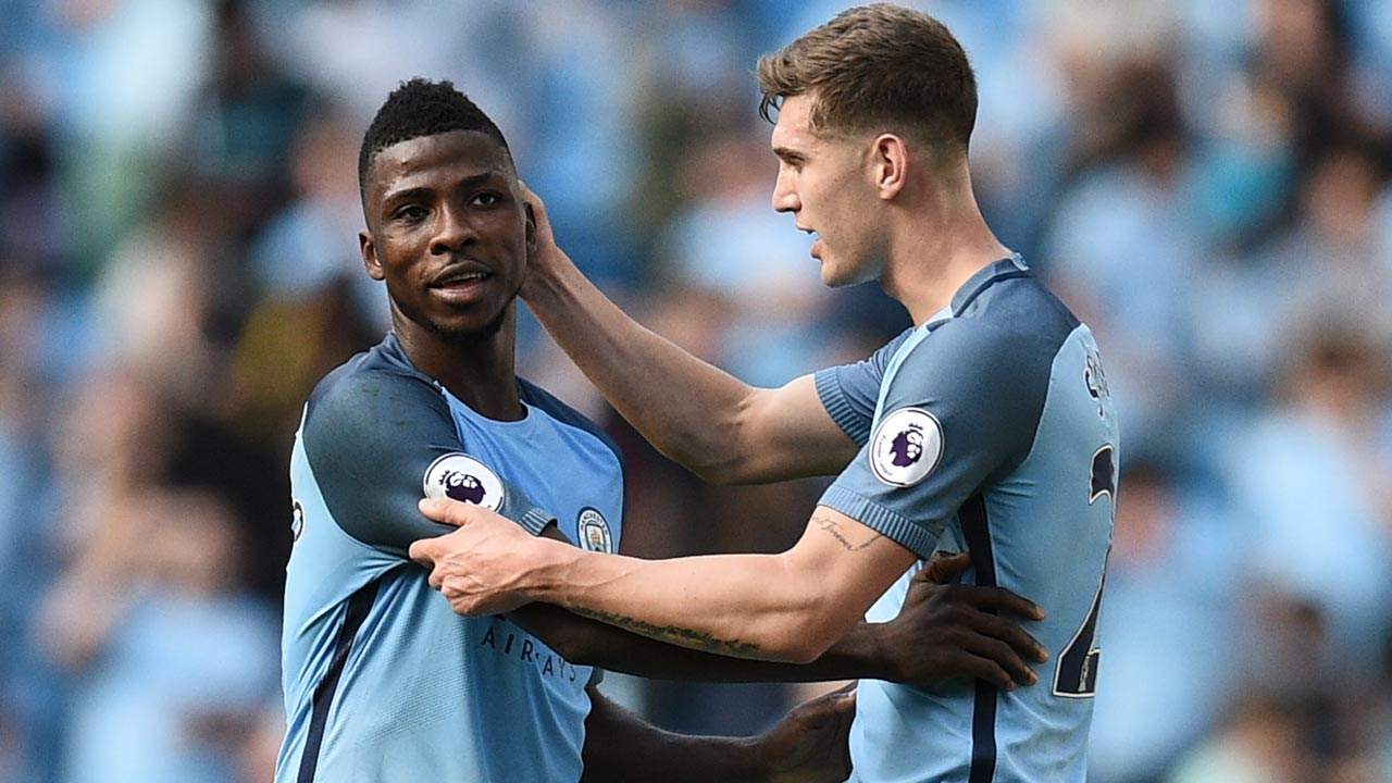 Manchester City's Nigerian striker Kelechi Iheanacho (L) and Manchester City's English defender John Stones (R) celebrate at the end of the English Premier League football match between Manchester City and Bournemouth at the Etihad Stadium in Manchester, north west England, on September 17, 2016. PHOTO: OLI SCARFF / AFP