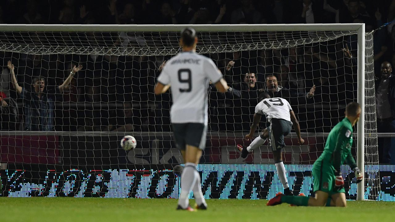 Manchester United's English striker Marcus Rashford (2R) scores his team's thrid goal during the English League Cup third round football match between Northampton Town and Manchester United at the Sixfields Stadium in Northampton, central England, on September 21, 2016. Ben STANSALL / AFP