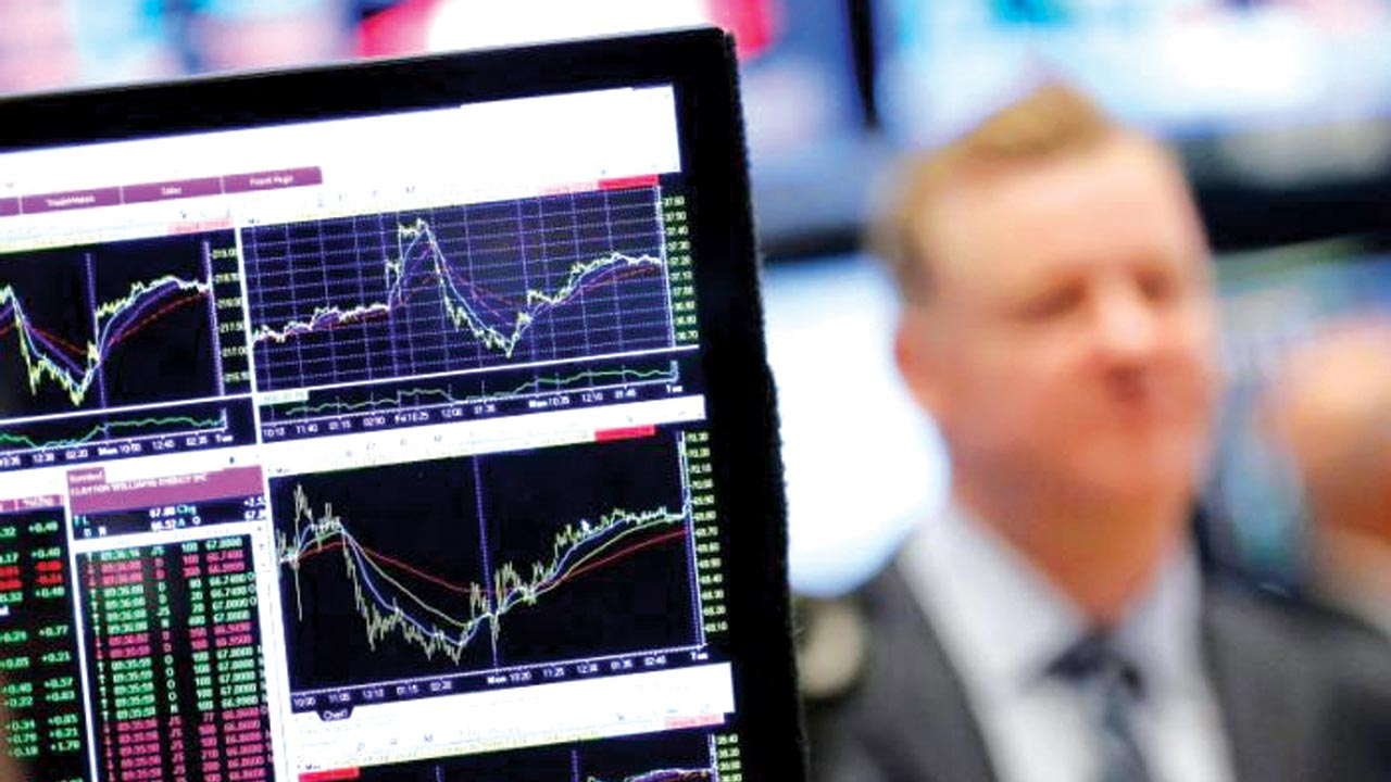 A monitor is pictured as a trader works on the floor of the New York Stock Exchange (NYSE) shortly after the opening bell in New York, U.S. Photo: REUTERS