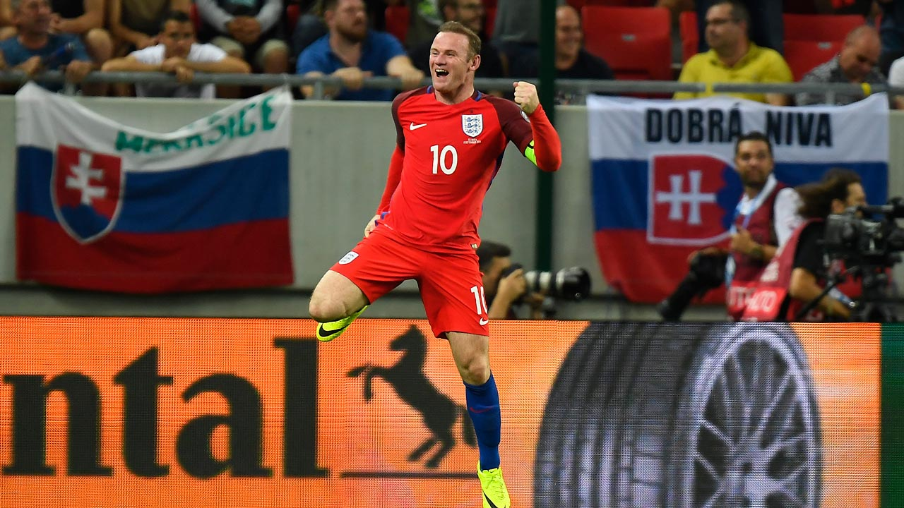 England's forward Wayne Rooney celebrates the winning goal for England during the World Cup 2018 football qualification match between Slovakia and England in Trnava, Slovakia, on September 4, 2015. PHOTO: JOE KLAMAR / AFP