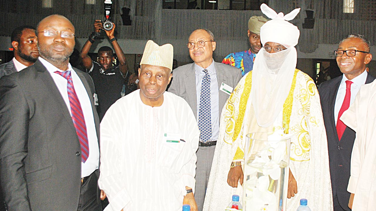 Chairman, Afrinvest (West Africa) Limited, Dr. Fidelis Ndeh-Che (left); former Chairman, Afrinvest, Apostle Hayford Alile; Professor of Political Economy, Pat Utomi; Emir of Kano, Muhammadu Sanusi II; and Managing Director, Afrinvest, Mr. Ike Chioke, at the launch of the Nigerian Banking Sector Report 2016 in Lagos...yesterday. PHOTO: AYODELE ADENIRAN