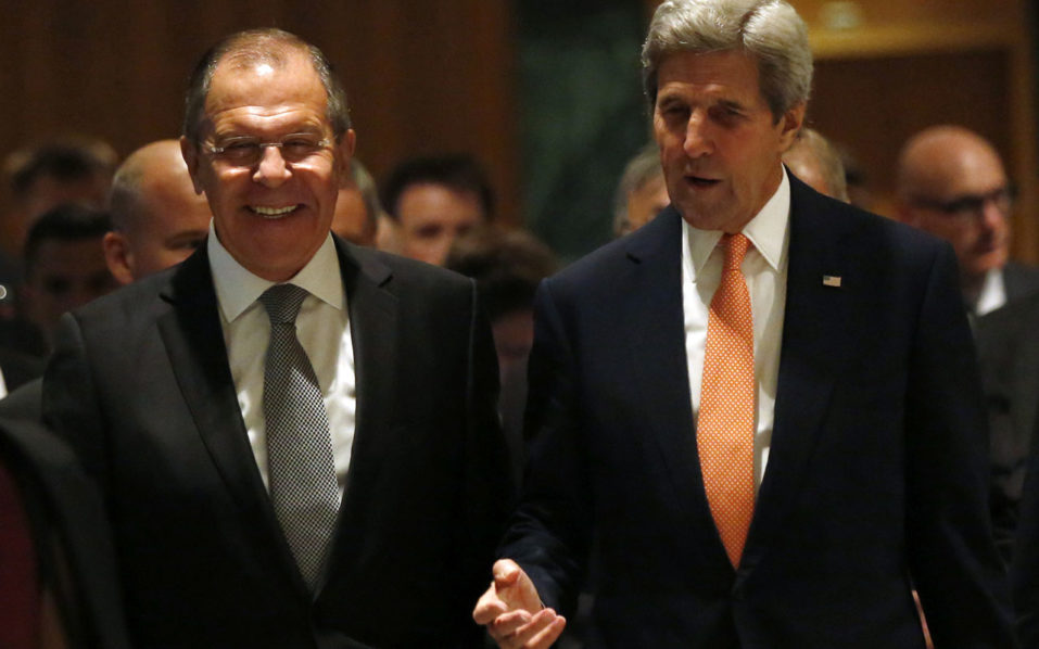 US Secretary of State John Kerry (R) and Russian Minister for Foreign Affairs Sergei Lavrov (L) speak as they arrive for a meeting to discuss the Syrian crisis on September 9, 2016, in Geneva. The United States and Russia will make a fresh bid to end the bloodshed in Syria on September 9, 2016 as Moscow-backed regime forces make new advances against rebel fighters on the ground. US Secretary of State John Kerry flew into Geneva for crunch talks with his Russian counterpart Sergei Lavrov, with Washington warning talks could not go on forever without a breakthrough. The two powers back opposite sides in the five-year conflict, with Moscow supporting the regime of President Bashar al-Assad and the US behind the rebels. / AFP PHOTO / POOL / KEVIN LAMARQUE