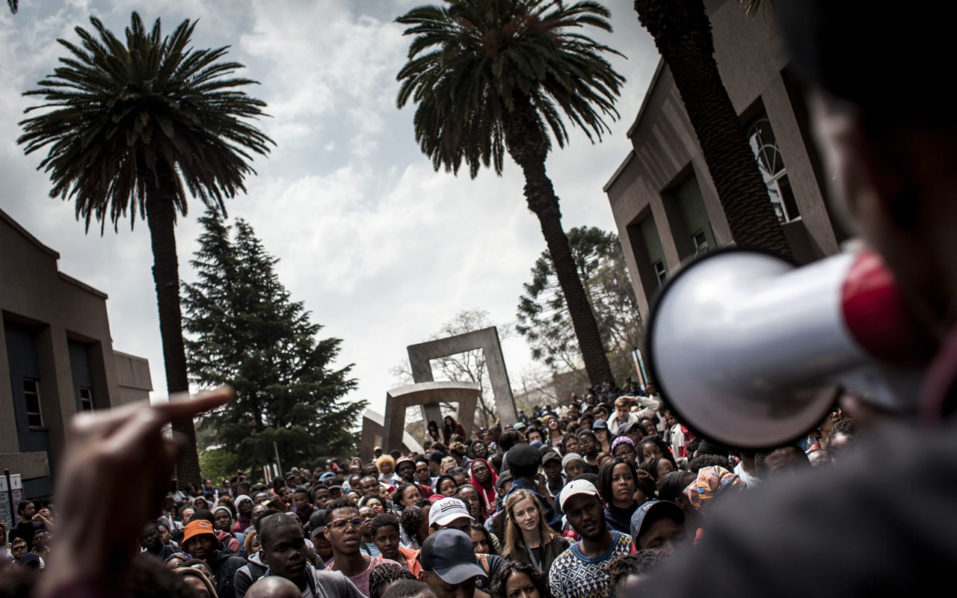 Students at the University of the Witwatersrand (WITS), demonstrate at the Senate house to protest against the fee increase next year on September 19, 2016 in Johannesburg. South Africa on September 19, 2016 gave universities the go-ahead to raise student fees by up to eight percent, prompting protests on several campuses across the country. Student groups last year secured a zero percent fee increase after weeks of demonstrations rocked the government, and had demanded a freeze on all fees until a commission into university funding was complete. / AFP PHOTO / JOHN WESSELS