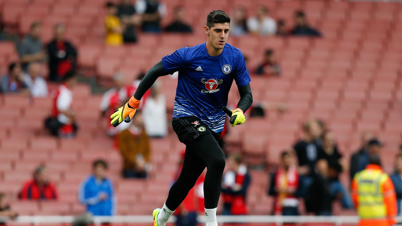 Chelsea's Belgian goalkeeper Thibaut Courtois warms up before kick off of the English Premier League football match between Arsenal and Chelsea at The Emirates stadium in London, on September 24, 2016. Ian Kington / IKIMAGES / AFP