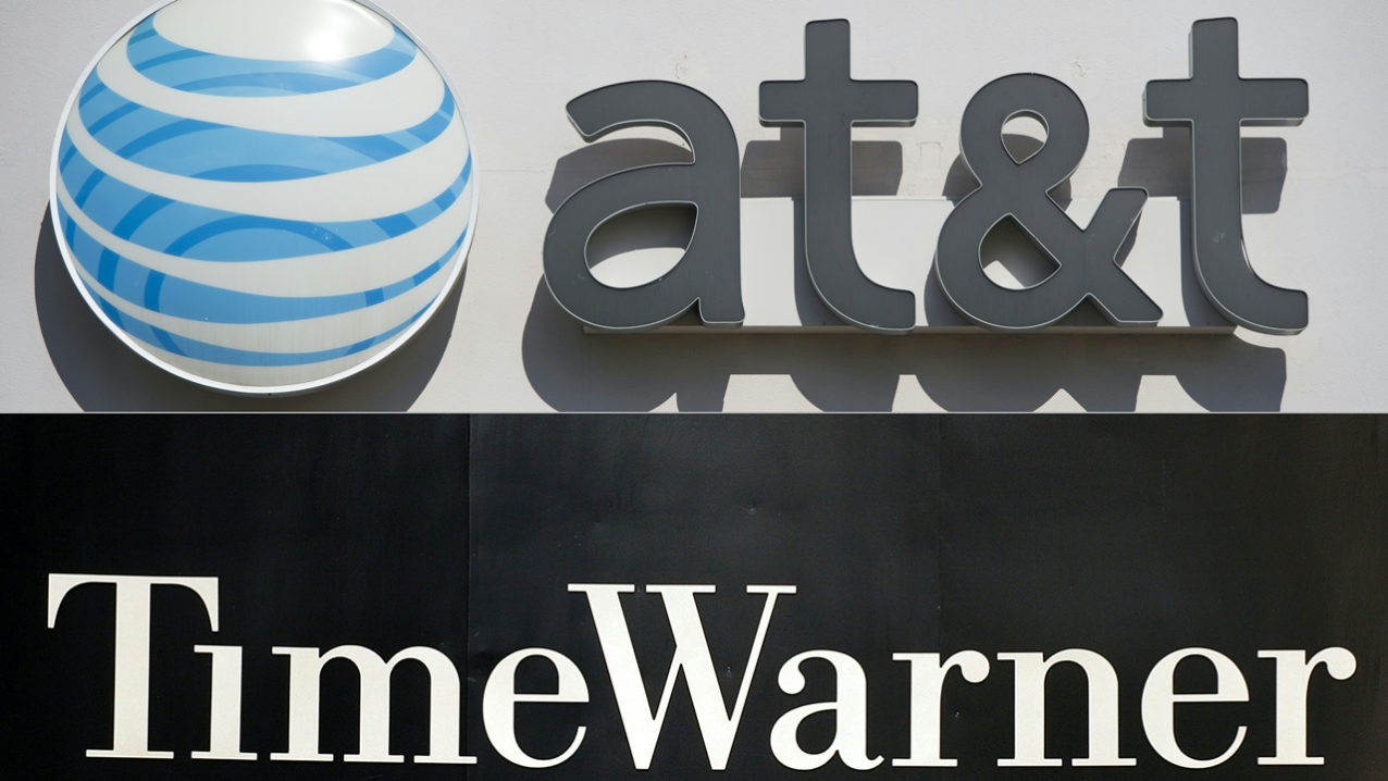 FILES): This combination of pictures created on October 21, 2016 shows an AT&T cellphone store (TOP) in Springfield, Virginia, on October 23, 2014, and the Time Warner company logo on the front of the headquarters building, 24 November, 2003 in New York. Telecom heavyweight AT&T has struck a deal to buy entertainment powerhouse Time Warner for $108.7 billion, October 22, 2015 to create a media-tech behemoth. STAN HONDA SAUL LOEB / AFP