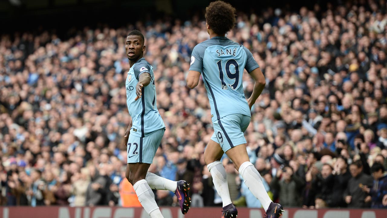 Manchester City's Nigerian striker Kelechi Iheanacho (L) celebrates with Manchester City's German midfielder Leroy Sane (R) after scoring their first goal during the English Premier League football match between Manchester City and Southampton at the Etihad Stadium in Manchester, north west England, on October 23, 2016. PHOTO: Oli SCARFF / AFP