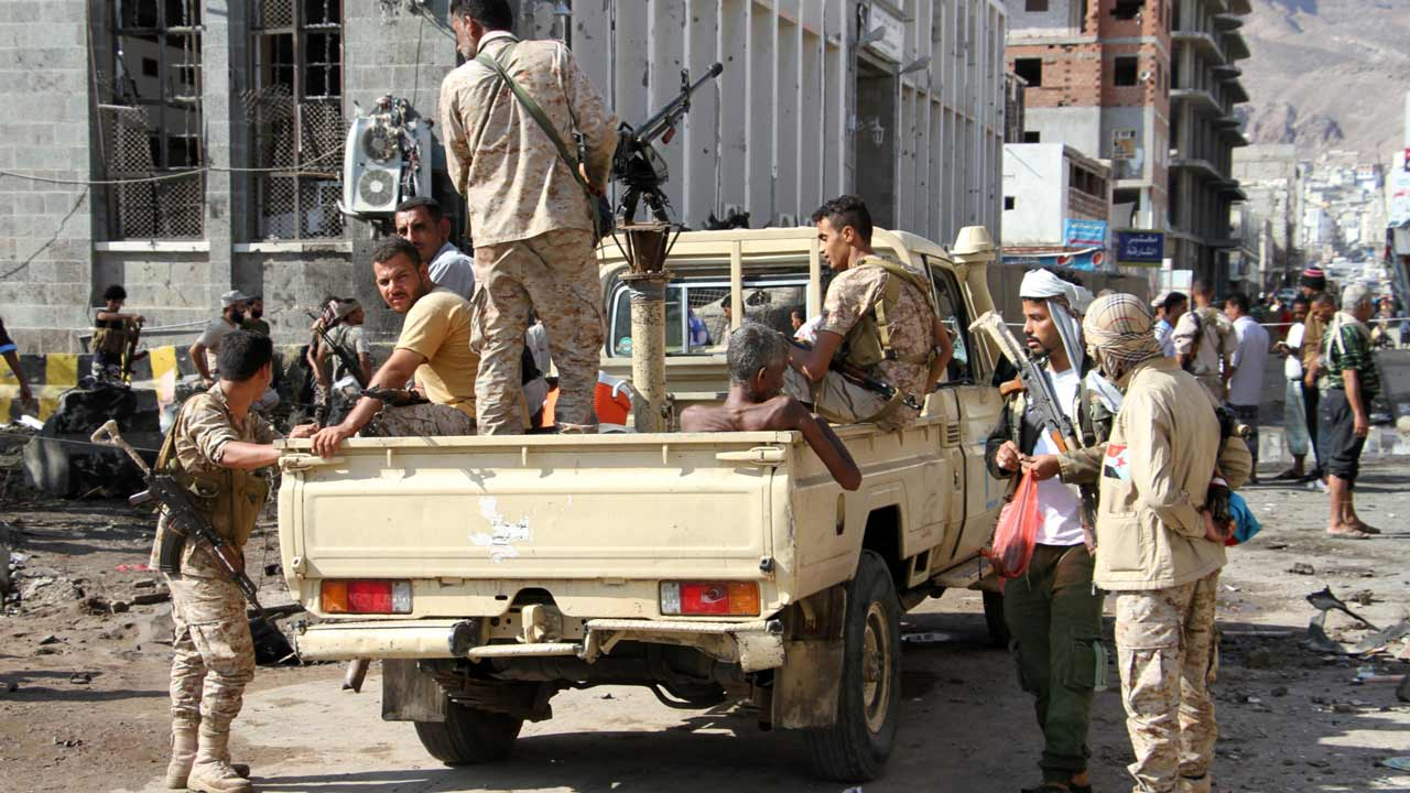 Yemeni security forces gather at the site where a suicide car bomb exploded next to the central bank in Yemen's second city Aden on October 29, 2016. A bomb-laden vehicle driven by a suicide bomber heading towards the exploded before reaching its target, a security official said. As the vehicle approached the bank, guards protecting the facility opened fire causing the car to explode 30 metres away from its target, the official told AFP. PHOTO: SALEH AL-OBEIDI / AFP