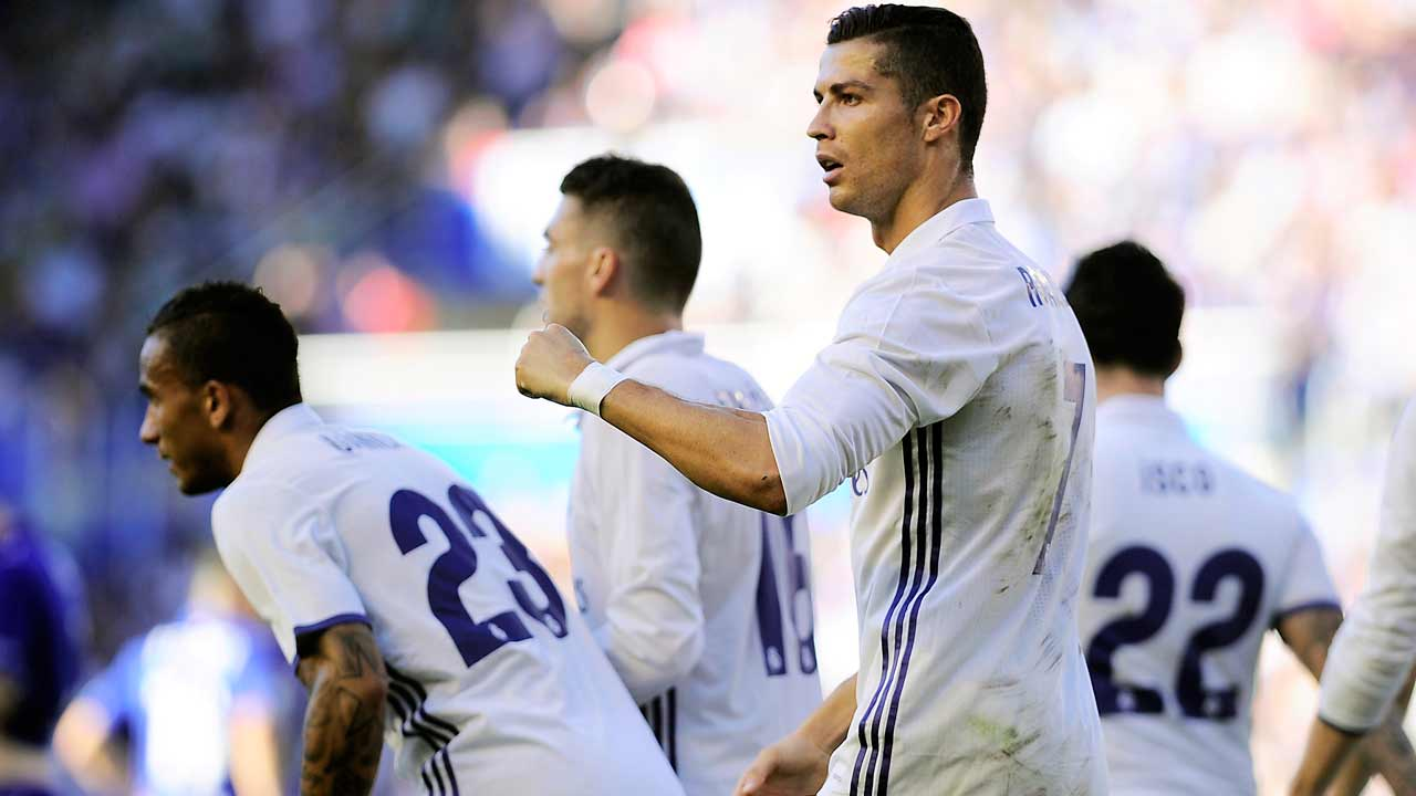 Real Madrid's Portuguese forward Cristiano Ronaldo (R) celebrates after scoring his team's second goal during the Spanish league football match between Deportivo Alaves and Real Madrid CF at the Mendizorroza stadium in Vitoria on October 29, 2016. PHOTO: ANDER GILLENEA / AFP