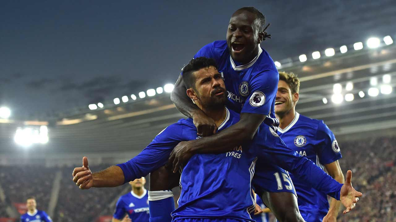 Chelsea's Brazilian-born Spanish striker Diego Costa (C) celebrates scoring their second goal with Chelsea's Nigerian midfielder Victor Moses (top) during the English Premier League football match between Southampton and Chelsea at St Mary's Stadium in Southampton, southern England on October 30, 2016. PHOTO: GLYN KIRK / AFP