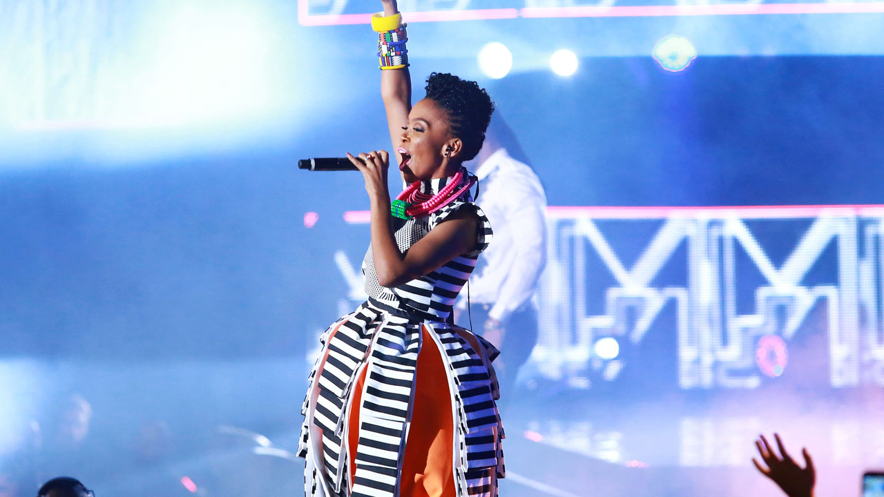 "(FILES) This file photo taken on June 7, 2014 shows one of the lead singers from the South African group Mafikizolo performing at the MTV Africa Awards held at the International Convention Centre (ICC) in Durban. A burgeoning market in Africa for homegrown contemporary music is sweeping the continent and driving a creative boom in an industry otherwise battered by falling CD sales and rampant piracy. October 22 and October 23, 2016 African talent will be celebrated in Johannesburg at the annual MTV Africa awards set up in 2008 to recognise those ""who have made the most impact on African music and youth culture"". / AFP PHOTO / RAJESH JANTILAL"