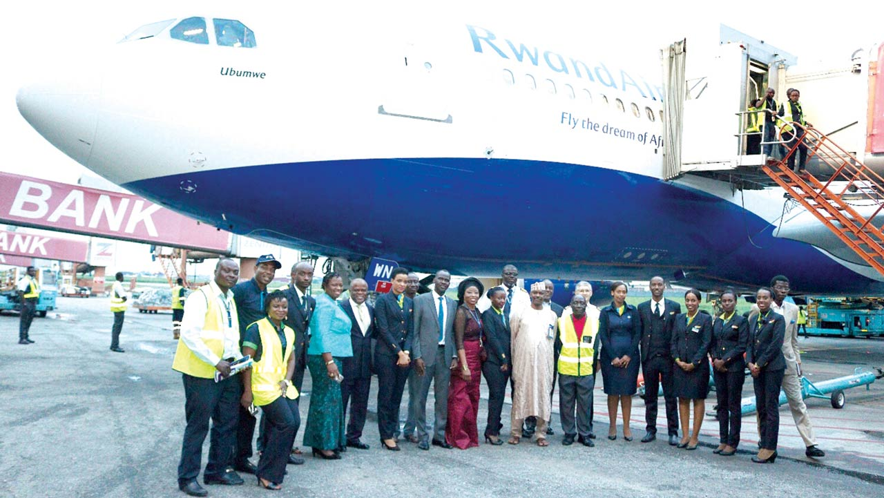 Crew, dignitaries, and officials at the welcome of RwandAir's Airbus in Lagos