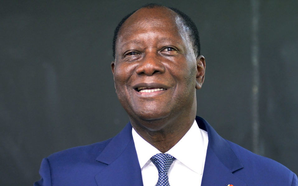 Ivory Coast's President Alassane Ouattara casts his vote in the ballot box, at a polling station in Abidjan, on October 30, 2016, during a vote for a referendum on a new constitution. Voters in Ivory Coast went to the polls on October 30, 2016 to determine the fate of constitutional changes that President Alassane Ouattara says will help end years of instability and unrest linked to the vexed issue of national identity. / AFP PHOTO / SIA KAMBOU