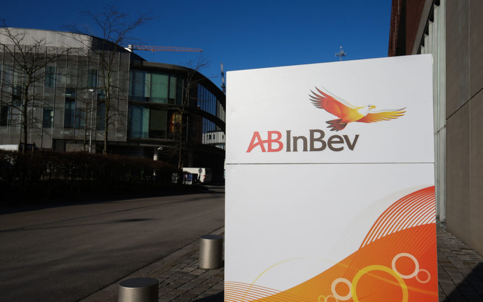 the Anheuser-Busch InBev (AB INBEV) logo at the entrance of the offices ahead of a press conference on the 2015 year results of brewery group Anheuser-Busch InBev, in Leuven. Coca-Cola intends to buy the stake global beer giant Anheuser-Busch InBev holds in Coca-Cola Beverages Africa, the two companies announced on October 11, 2016. The proposed deal follows ABI's mega-takeover of SABMiller to create the world's biggest beer company. That buyout allowed the the Belgian-Brazilian maker of Budweiser and Stella Artois to recover the stake its British-South African rival held in Coca-Cola's African subsidiary.  / AFP PHOTO / BELGA / BRUNO FAHY