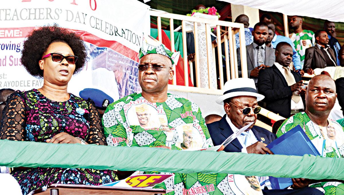 Wife of Ekiti State Governor, Feyisetan Fayose (left); her husband, Ayodele Fayose; Founder, ABUAD University, Afe Babalola and Chairman, state chapter of Nigeria Union of Teachers (NUT), Kayode Akosile, during the celebration of 2016 World Teachers' Day at Oluyemi Kayode Stadium in Ado-Ekiti… yesterday.