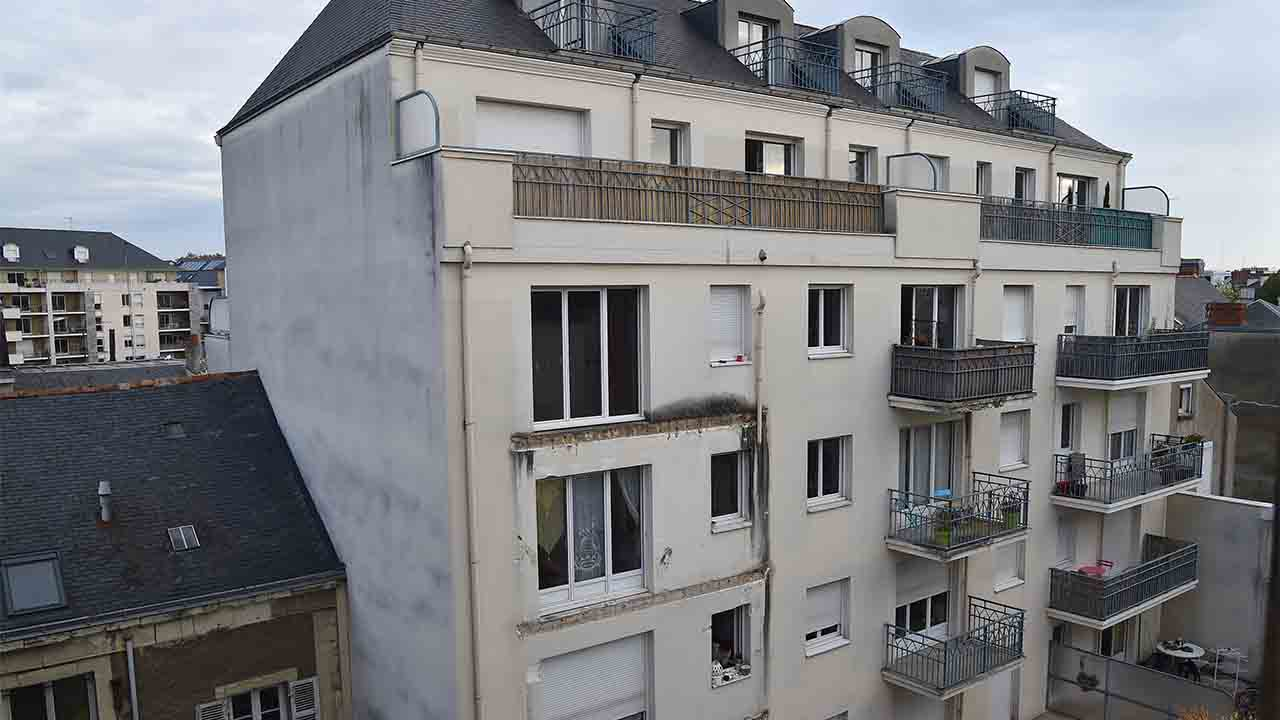 "A picture taken on October 16, 2016 shows the rear side of a building in which four people were killed and several others injured after a balcony collapsed, in Angers, northwestern France. Four people died and more than a dozen others were injured, some of them ""seriously"" but not in danger of death, after the collapse of a balcony in the building, according to the prefecture and hospital. A dozen people stood on the balcony on the third floor of the recently constructed building, when the accident occurred shortly before midnight on October 15. The balcony collapsed for an unknown reason, causing the balconies of the two lower floors to collapse as well, but according to sources close to the investigation, no one was on the lower balconies. / AFP PHOTO / JEAN-FRANCOIS MONIER"