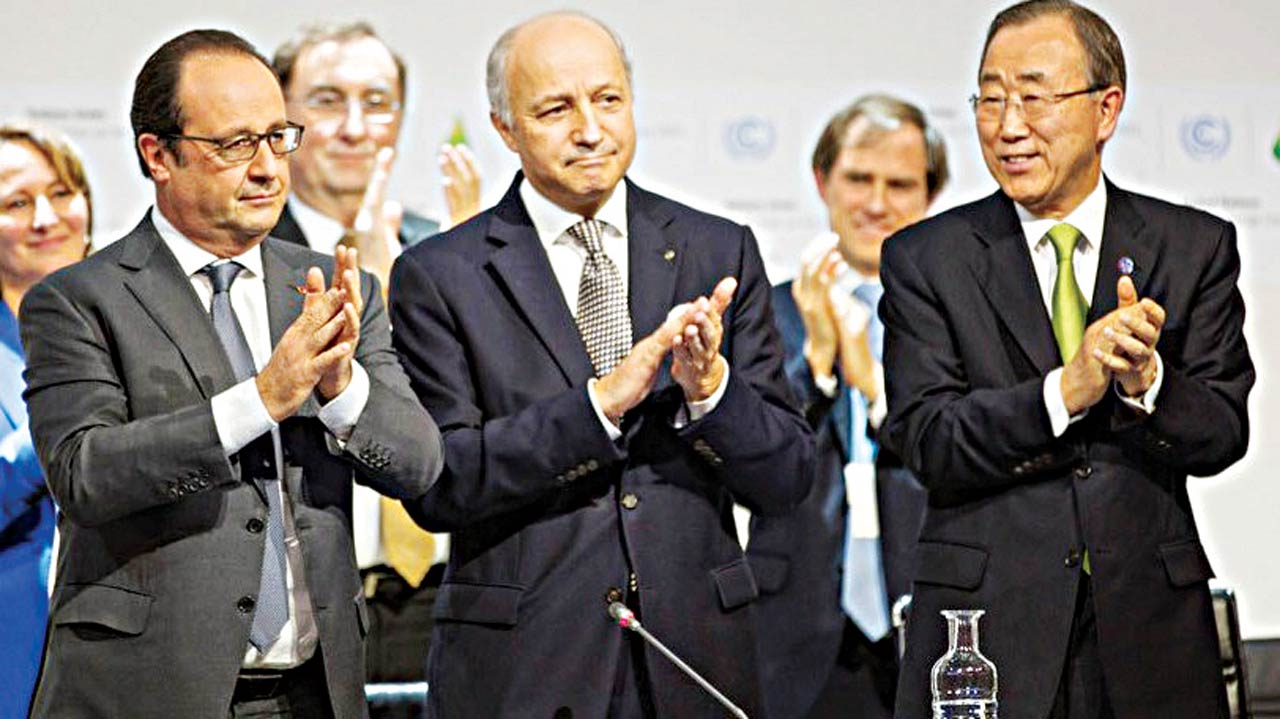 UN Secretary-General Ban Ki-moon (right), French Foreign Minister and COP21 President, Laurent Fabius (centre), and French President Franois Hollande (left) during the UN climate change conference in Paris. PHOTO: UNFCCC