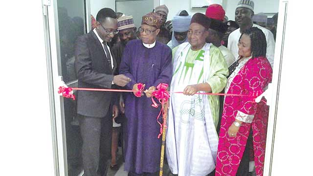 Minister of Information and Culture, Alhaji Lai Mohammed opening the exhibition… in Abuja