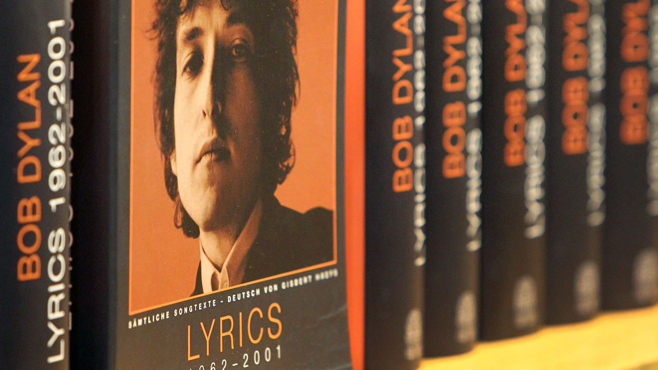 Books of the 2016 Literature Nobel Price winner US Bob Dylan are pictured at the booth of publisher Hoffman und Campe at the Frankfurt Book Fair in Frankfurt/Main, Germany, on October 19, 2016. The five-day Frankfurt fair, which opens to the public on October 19, is the world's largest publishing event. / AFP PHOTO / AMELIE QUERFURTH