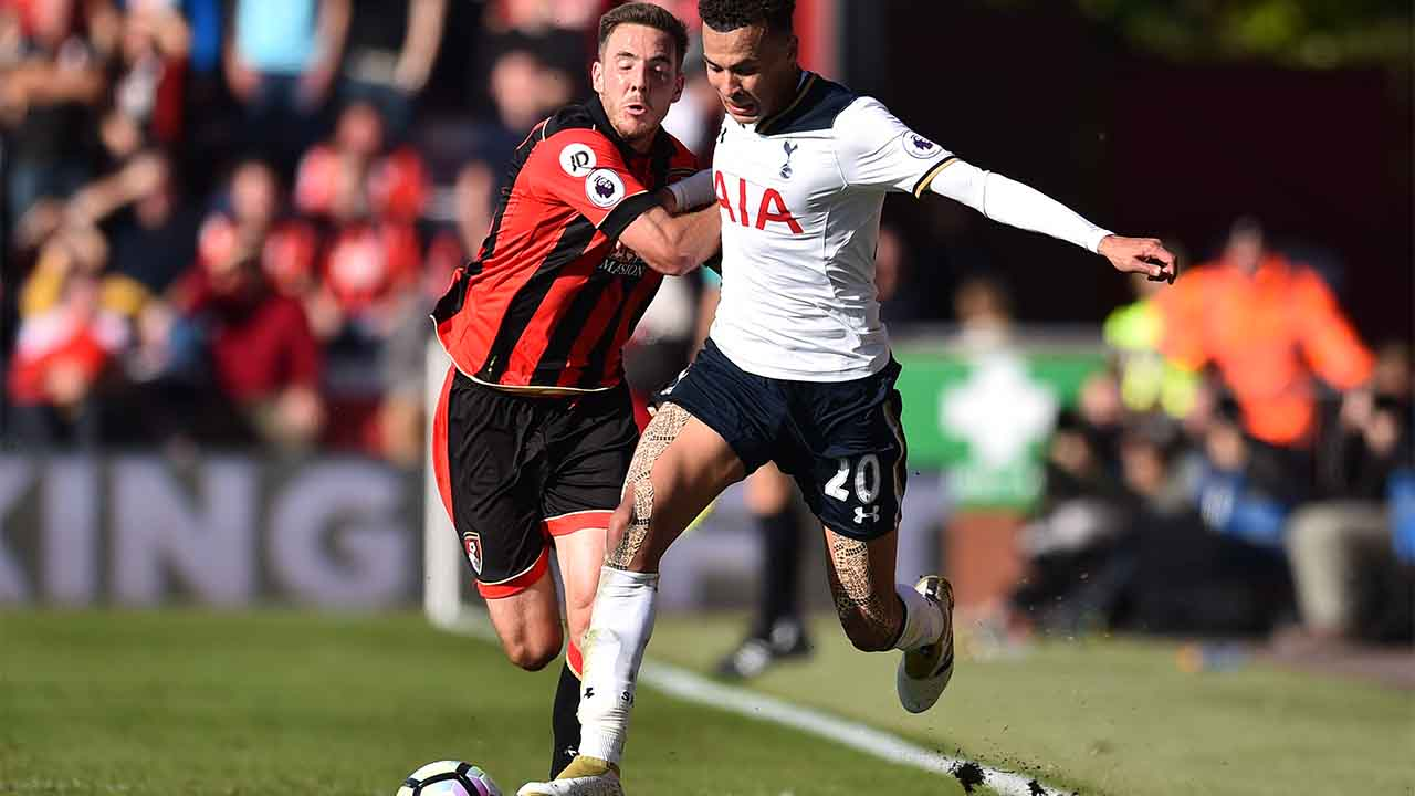 Bournemouth's English midfielder Dan Gosling (L) vies with Tottenham Hotspur's English midfielder Dele Alli during the English Premier League football match between Bournemouth and Tottenham Hotspur at the Vitality Stadium in Bournemouth, southern England on October 22, 2016. / AFP PHOTO / Glyn KIRK / RESTRICTED TO EDITORIAL USE. No use with unauthorized audio, video, data, fixture lists, club/league logos or 'live' services. Online in-match use limited to 75 images, no video emulation. No use in betting, games or single club/league/player publications. /