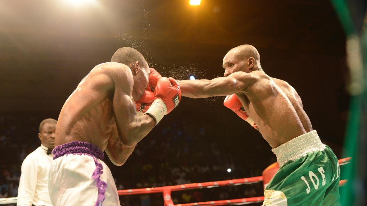 "Nigeria's Joe Boy lands a blow on Ghana's Richard ""Desert Warrior"" Amefu, whom he defeated via a unanimous decision in an eight round international challenge contest at the GOtv Boxing Night 9 held at the National Stadium, Lagos…at the weekend."