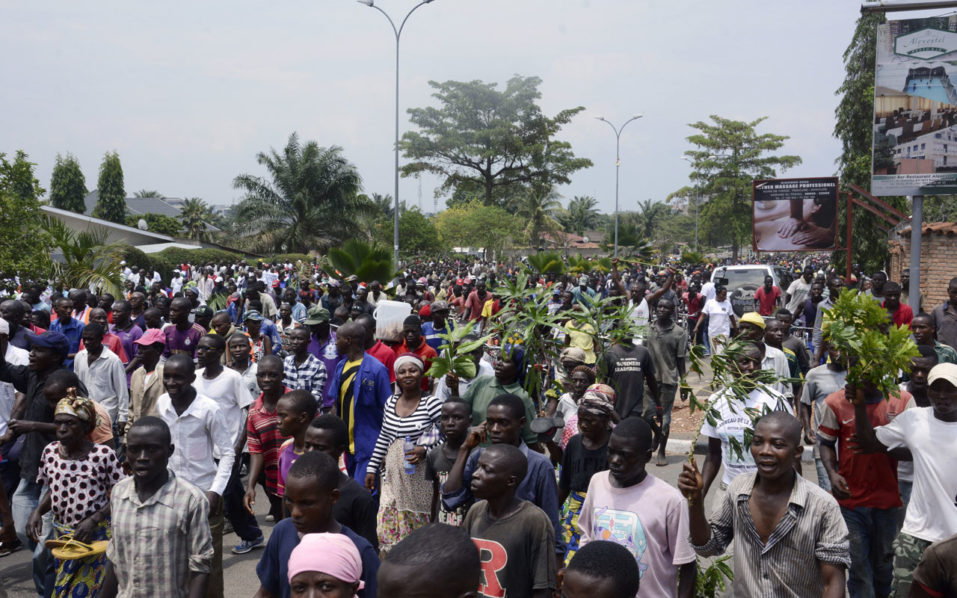 "People demonstrate against the European Union, the International Criminal Court and the Resolution against Burundi in Bujumbura on October 8, 2016. Burundi announced plans on October 7, 2016 to withdraw from the International Criminal Court (ICC), a week after the UN began an enquiry into human rights abuses committed since April 2015. ""It is perfectly clear that this is a plot to do harm to Burundi,"" said Gaston Sindimwo, Burundi's vice president, citing European Union ""pressure"" allegedly exerted on the UN, which opened a rights investigation a week ago. According to a list seen by AFP, the UN investigation is targeting a dozen members of the governing regime, including General Alain-Guillaume Bunyoni, regarded as the second most powerful figure after President Pierre Nkurunziza. / AFP PHOTO / STRINGER"