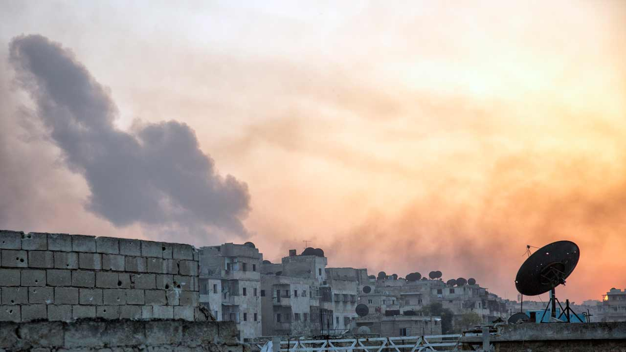 "Smoke billows from the frontline district of Dahiyet al-Assad following an attack by rebels on Syrian regime forces in the northern city of Aleppo on October 29, 2016. Car bombs and rocket fire shook Aleppo as rebels battled to break a suffocating siege by the Syrian regime, accused by Washington of using starvation as a ""weapon of war"". KARAM AL-MASRI / AFP"