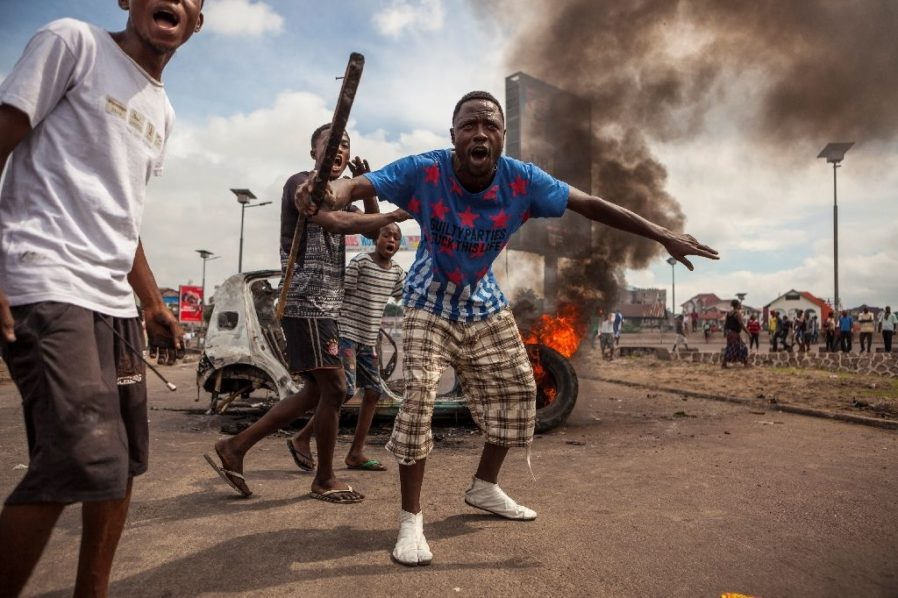 More than 50 people died in clashes in the capital of Democratic Republic of Congo, Kinshasa, in September as the opposition called on President Joseph Kabila to step down (AFP Photo/Eduardo Soteras)