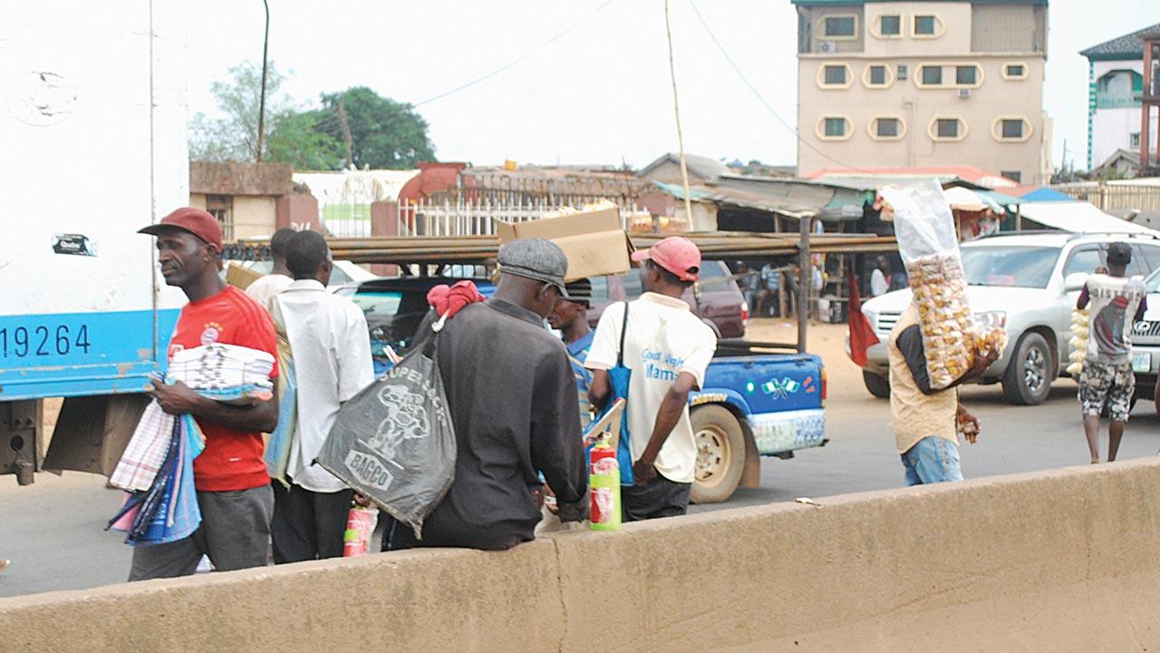Hawkers along Lagos Abeokuta Expressway PHOTO: AYODELE ADENIRAN