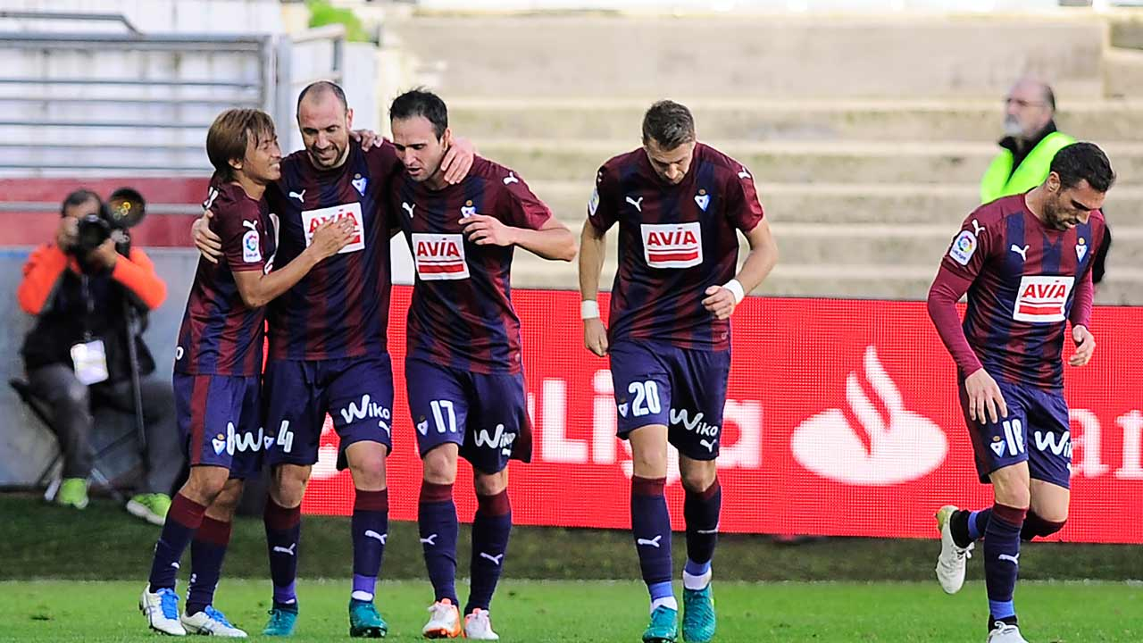 Eibar's defender Ivan Ramis (2nd L) celebrrates with teammates after scoring his team's first goal during the Spanish league football match between SD Eibar and Villarreal CF at the Ipurua stadium in Eibar on October 30, 2016. ANDER GILLENEA / AFP