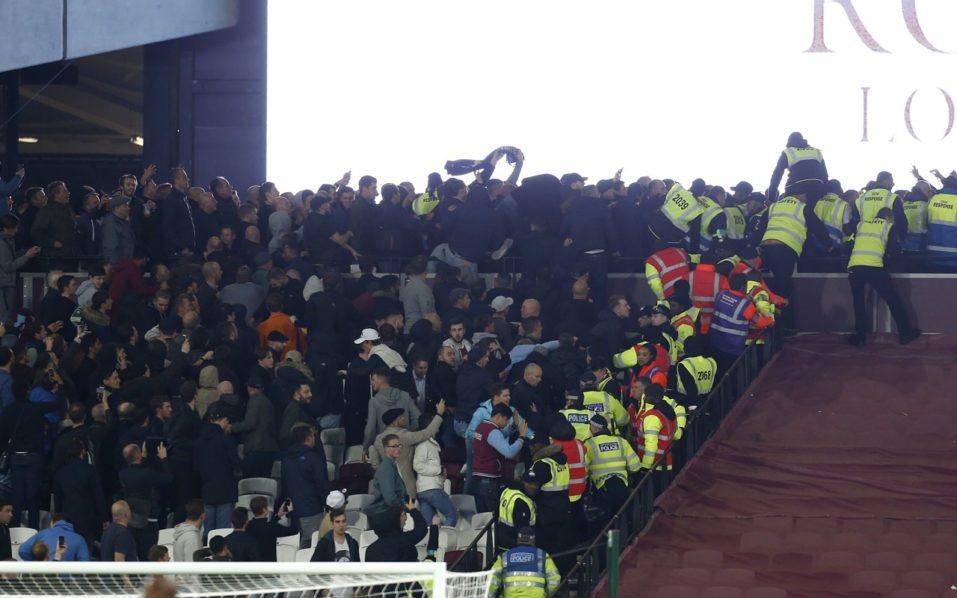 Police and stewards try to separate supporters of both sides as they confront each other during the EFL (English Football League) Cup fourth round match between West Ham United and Chelsea at The London Stadium in east London on October 26, 2016. West Ham won the game 2-1. / AFP PHOTO / Ian KINGTON /