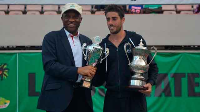 Secretary to the Lagos State Government, Tunji Bello (left); winner of men's singles, 16th edition of Governor's Cup Lagos Tennis Championship, Spain's Enrique Lopez- Perez at the Lagos Lawn Tennis club, Onikan… at the weekend.  				                   PHOTO: FEMI ADEBESIN-KUTI
