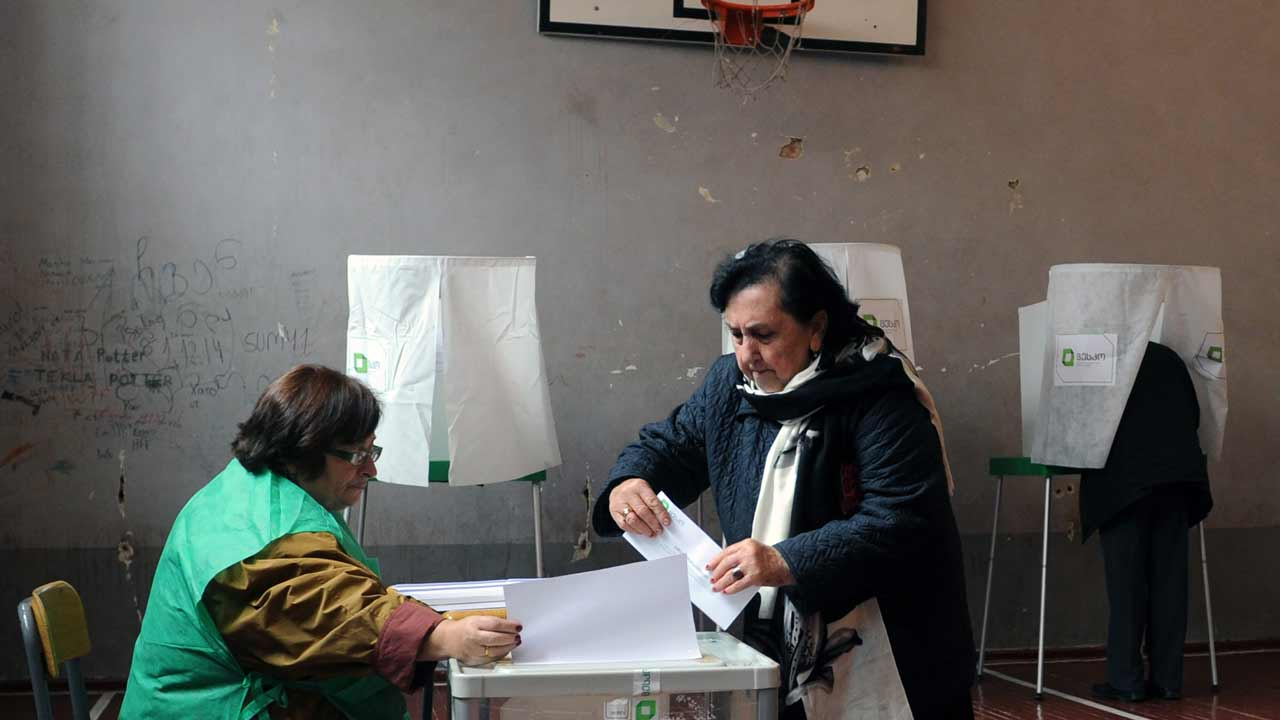 A woman votes at the polling station during the second round of parliamentary elections in Tbilisi on October 30, 2016 Voting, which started at 0400 GMT and will end at 1600 GMT, is being monitored by international observers from the Organisation for Security and Cooperation in Europe, the European Parliament, and NATO. Vano Shlamov / AFP