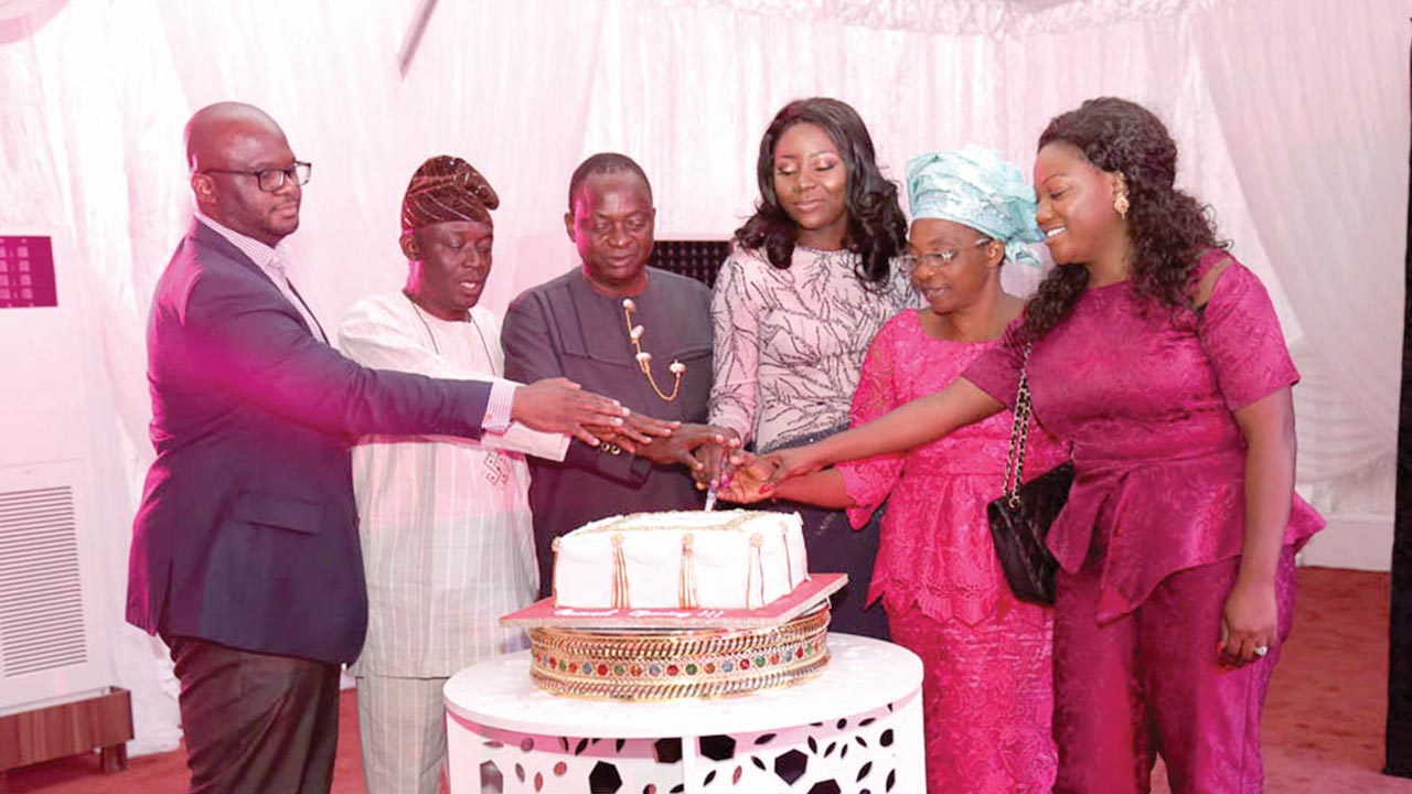 Glitz CEO, Adetola Juyitan (third right) cutting the launch cake with other guests.