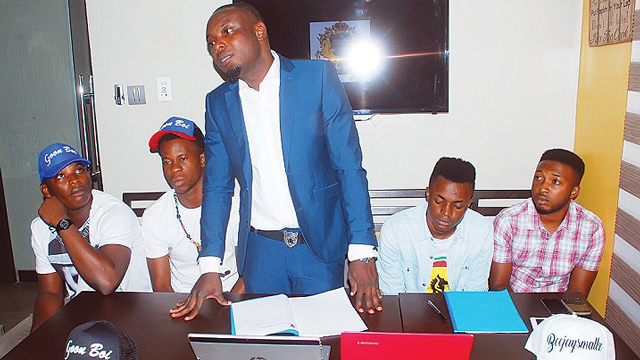 Soslimm Manager, Mr. Omonije Samuel Ayomide (left); Goon Boi; CEO, Soslimm Entertainment, Mr. Olumide Fadayo and Beejay Smallz at the signing ceremony… in Lagos