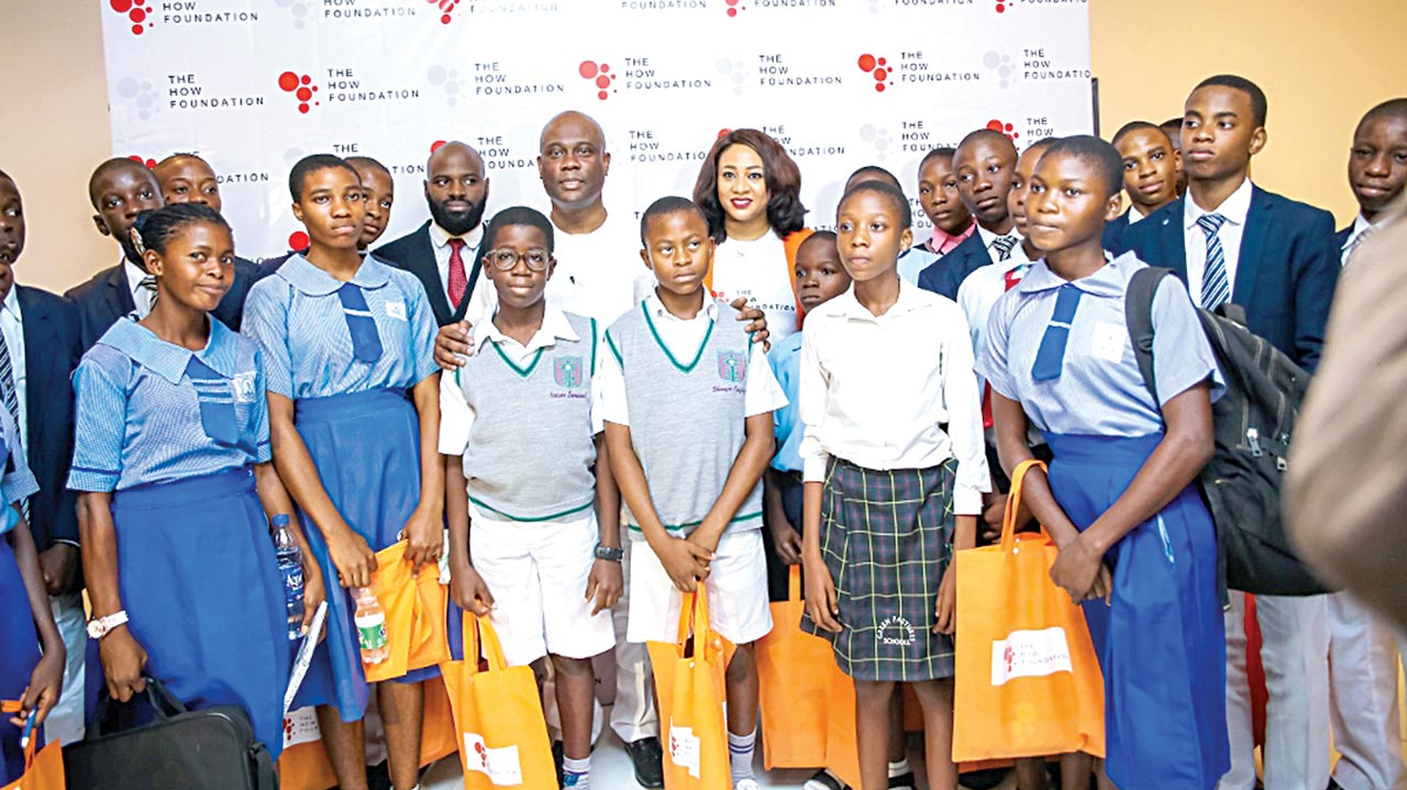 Herbert Wigwe, Joshua Ajitena and Antonia Ally in a group photograph with some of the students at the event