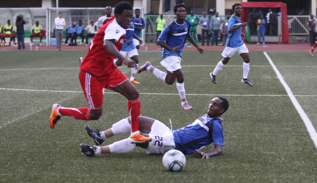 A Heartland attacker (left) takes on Enyimba's defence when the turf was smooth for the Owerri side. The Naze Millionaires will play in the second tier Nigerian National League (NNL) … next season.