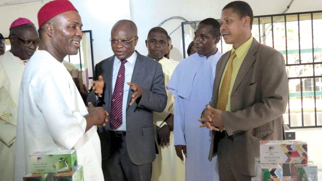 Bishop of Okigwe Catholic Diocese, Imo State, Dr. Solomon A. Amatu (left); Minister of Science and Technology, Dr. Ogbonnaya Onu; Professor of pharmacognocy and Chief Executive Officer (CEO)/Chairman of BDCP, Maurice Iwu; and others at the inauguration of the Bioprocessing plant of Bioresources Institute of Nigeria (BION) at Umuna, Okigwe Local Council of Imo state