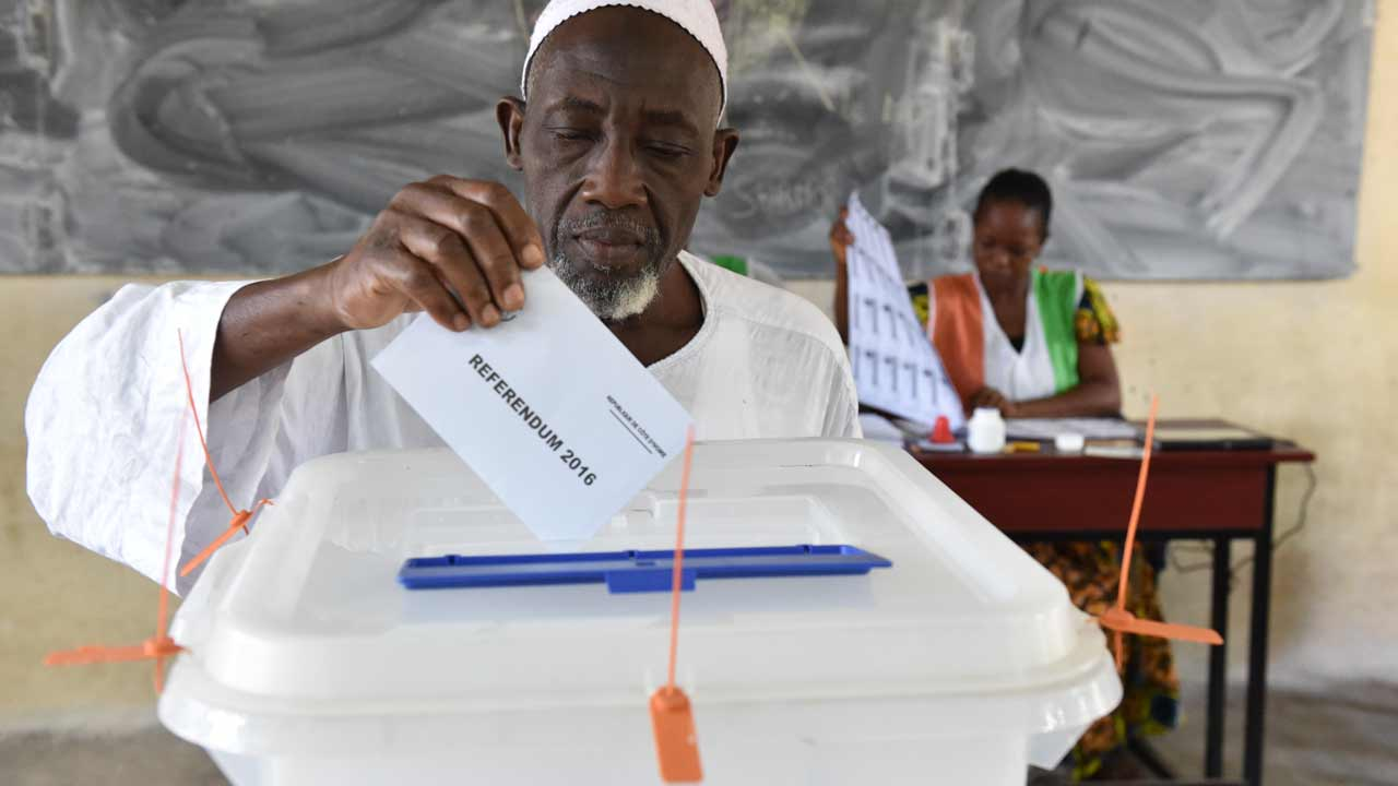 "A man casts his vote for a referendum on a new constitution on October 30, 2016 at a polling station in Yopougon, suburb of Abidjan. Ivory Coast goes to the polls to vote on constitutional changes that President Alassane Ouattara says will help to end years of instability and unrest linked to the vexed issue of ""Ivorian-ness"". ISSOUF SANOGO / AFP"