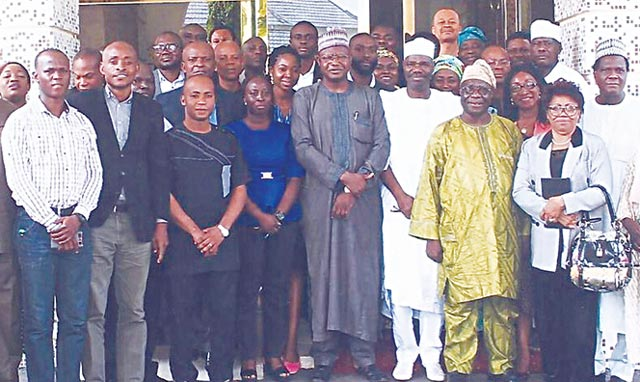 Minister of State for Environment Ibrahim Usman Jibrin (middle) with participants at the workshop in Abuja.