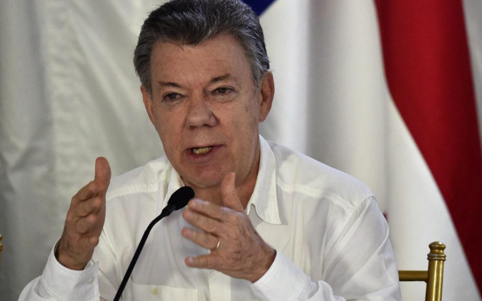 Juan Manuel Santos / AFP PHOTO / Rodrigo ARANGUA