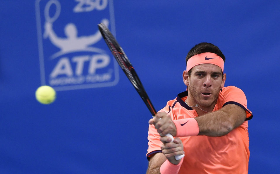 Argentina's Juan Martin Del Potro returns the ball to USA's Jack Sock during the final match of ATP Stockholm Open tennis tournament in Stockholm on October 23, 2016. / AFP PHOTO / JONATHAN NACKSTRAND