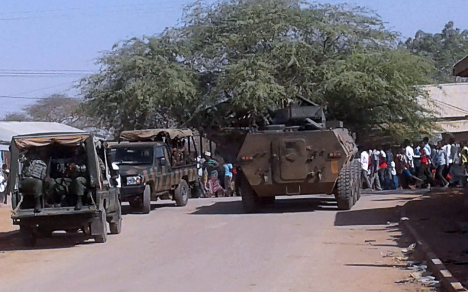 Kenya Defence Forces soldiers arrive at the scene of a bomb attack claimed by Shabaab militants in the northeastern town of Mandera, Northern Kenya. A bomb blast at a guesthouse in northeast Kenya killed at least 12 people on Tuesday, in an attack claimed by Shabaab militants who last hit the area earlier this month. / AFP PHOTO / STRINGER