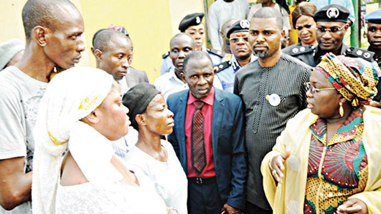Deputy Governor of Lagos State, Dr. Idiat Adebule (right) condoling with parents of some of the kidnapped students of Lagos State Model College, Igbonla, Epe, Lagos State. With her is lawmaker representing Epe Constituency II in the Lagos State House of Assembly Olusegun Olulade (second right); Commissioner of Police Fatai Owoseni (behind Olulade) and the school's principal Mr. Olukorede Osidero (in tie) among others.
