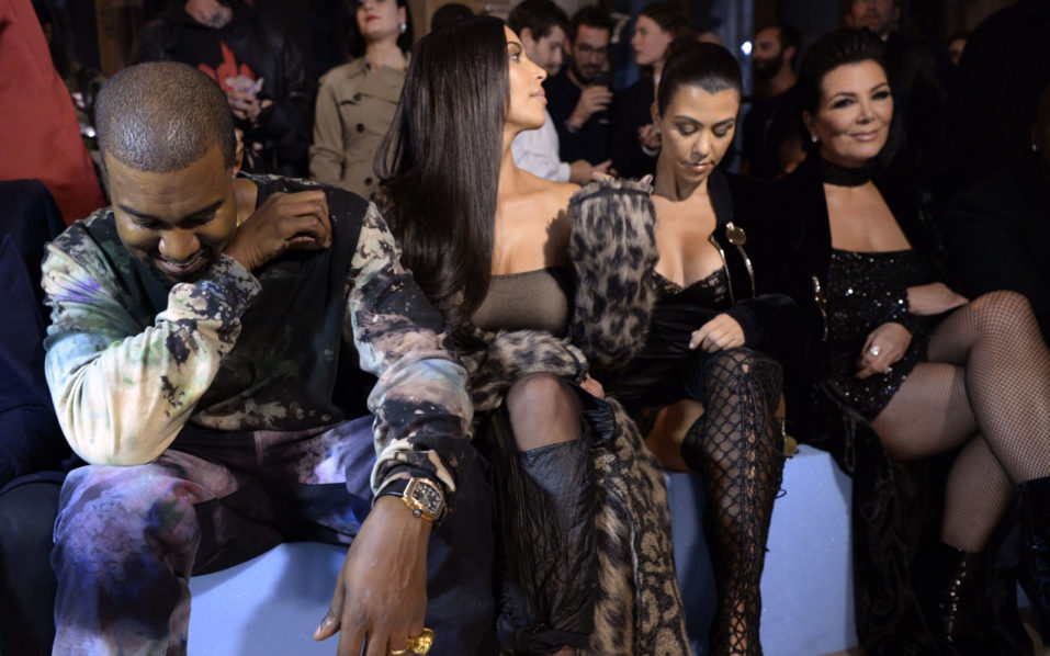 (From L) Kanye West, Kim Kardashian, Kourtney Kardashian and Kris Jenner attend the Off-white 2017 Spring/Summer ready-to-wear collection fashion show, on September 29, 2016 in Paris. / AFP PHOTO / ALAIN JOCARD