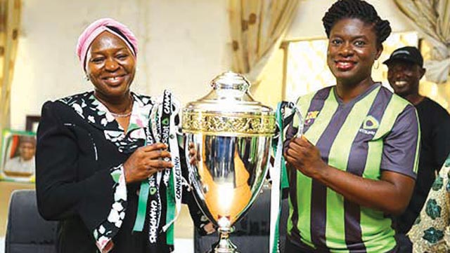 Permanent Secretary, Kwara State Ministry of Education, Mariam Ayodeji-Garba (left), and Manager, Sponsorship, Etisalat Nigeria, Orah Egwu, with the Champions Trophy during a courtesy visit to the Ministry by Etisalat Nigeria as part of the activities to mark the kick-off of the Etisalat School Cup season 3 Regional Play-Off in the State… on Tuesday.